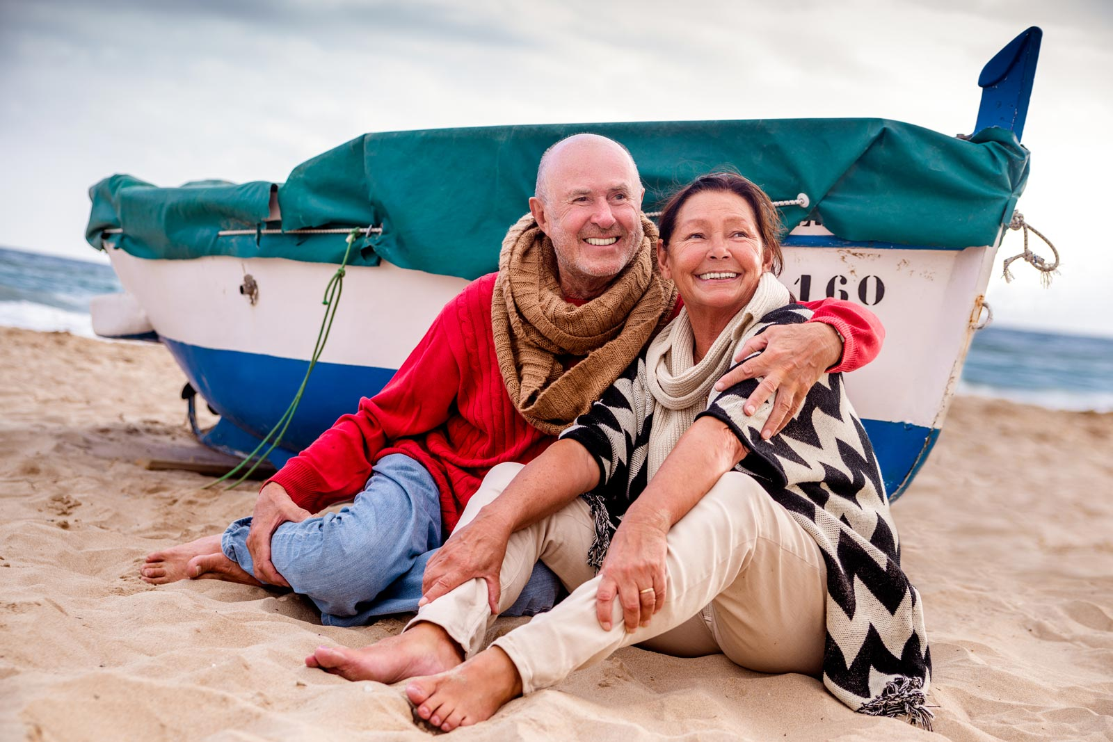 Happy old couple on the beach